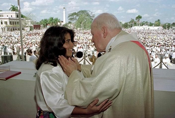 Pope John Paul II embraces a Cuban girl after delivering his remarks at a Mass dedicated to youth in Camaguay, Cuba, 1988 (AFP Photo/Arturo Mari)