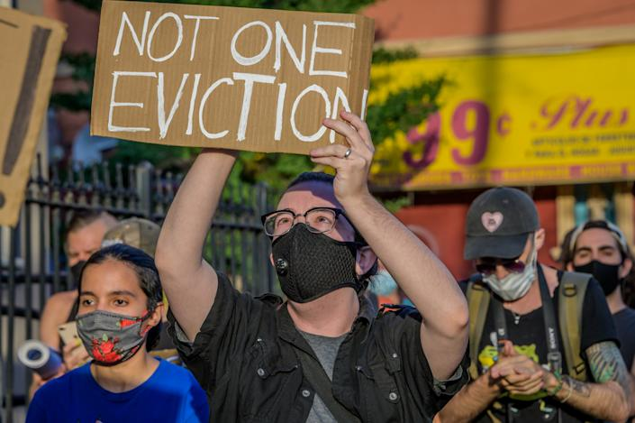 A participant holding a Not One Eviction sign at the protest. Tenants and Housing Activists dropped banners from their buildings and organized a march in the streets of Bushwick demanding the city to cancel rent immediately as the financial situation for many New Yorkers remains the same, strapped for cash and out of work. (Erik McGregor/LightRocket via Getty Images)