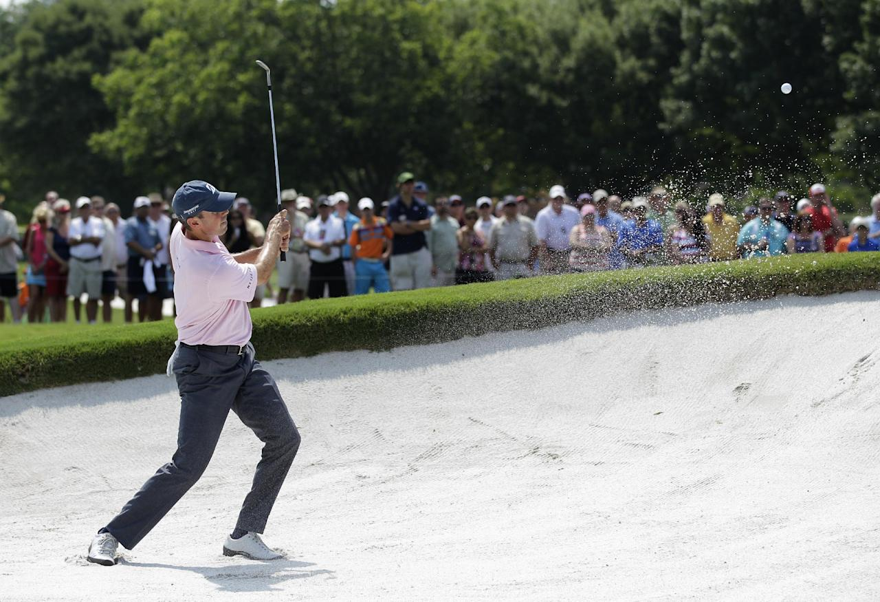 Matt Kuchar hits out of a bunker onto the sixth green during the second round of the PGA Colonial golf tournament Friday, May 25, 2012, in Fort Worth, Texas. (AP Photo/Tony Gutierrez)