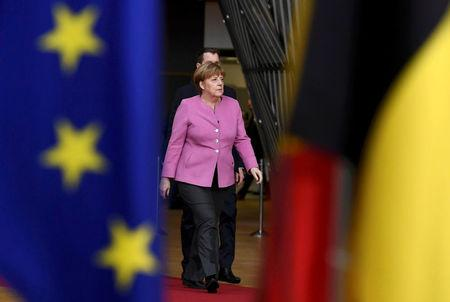FILE PHOTO: German Chancellor Angela Merkel arrives at the EU summit in Brussels