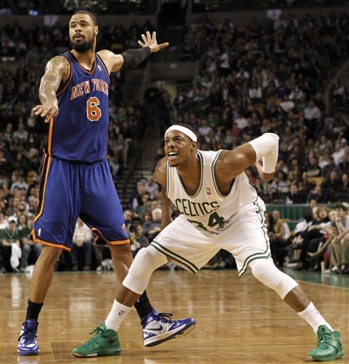 Boston Celtics' Paul Pierce (34) and New York Knicks' Tyson Chandler (6) watch a 3-point shot by Pierce during the second quarter of an NBA basketball game in Boston on Friday, Feb. 3, 2012. (AP Photo/Winslow Townson)