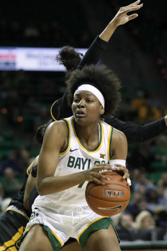 Baylor forward NaLyssa Smith (1) works to shoot against Grambling State's Jasmine Forte, rear, in the second half of an NCAA college basketball game in Waco, Texas, Friday, Nov. 8, 2019. (AP Photo/Tony Gutierrez)