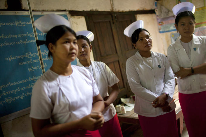 In this Aug. 31, 2012 photo, village nurses, who are also midwives, gather at a village health room during a briefing meeting given by a UNICEF child nutrition specialist in Zee Phyu Kwin village, near Pathein, in Irrawaddy Delta, Myanmar. Myanmar spent less than $1 per person on health in 2008, minus donor money, and ranks among the lowest countries in nearly every category of health care funding. Now, with the dramatic change that has given Myanmar an elected government, there are hopes for improvement, but the country faces a long climb. (AP Photo/Alexander F. Yuan)