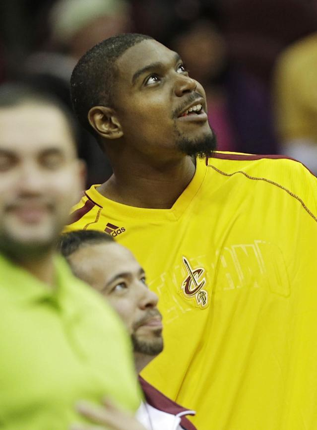 Cleveland Cavaliers' Andrew Bynum watches from the bench in the second quarter of a preseason NBA basketball game against the Detroit Pistons on Thursday, Oct. 17, 2013, in Cleveland. (AP Photo/Mark Duncan)