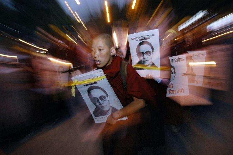 Chinese authorities have cremated the body of a revered Tibetan monk, Tenzin Delek Rinpoche, against his family's wishes, rights groups say, after the his death in prison was announced