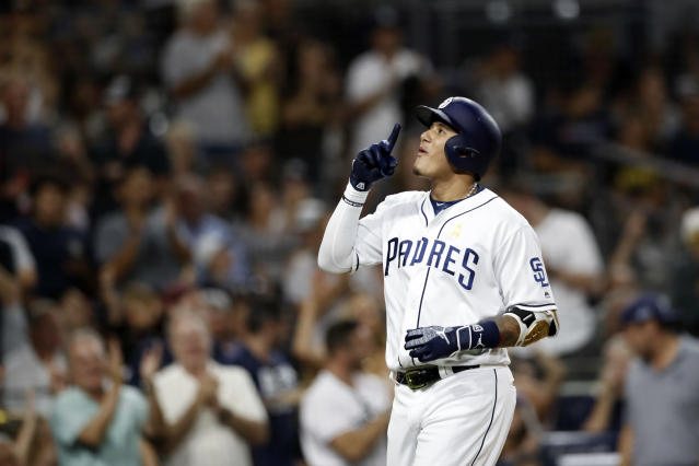 San Diego Padres' Manny Machado reacts after hitting a two-run home run during the sixth inning of a baseball game against the Colorado Rockies, Saturday, Sept. 7, 2019, in San Diego. (AP Photo/Gregory Bull)