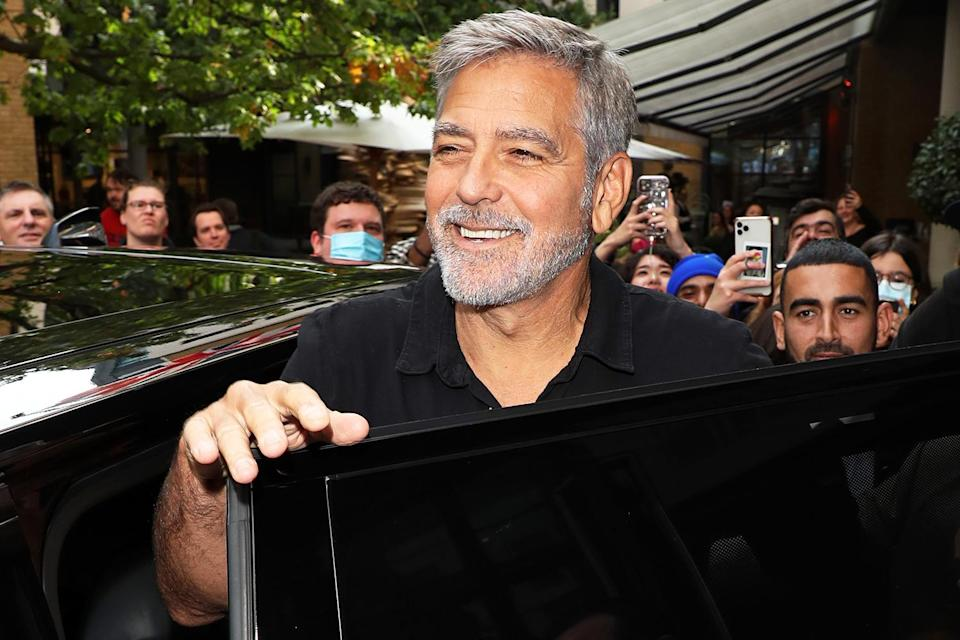 <p>George Clooney smiles for the fans while promoting new film <em>The Tender Bar,</em> which he directed, at the London Film Festival on Oct. 9. </p>