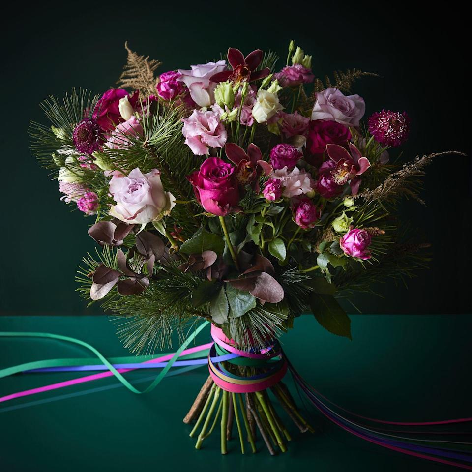 <p>Alternatively, ditch traditional festive reds and welcome shades of pink with this Christmas bouquet. Here, burgundy cymbidium orchids are combined with premium red lilac and cerise roses, soft gold asparagus fern and scented foliages.</p>