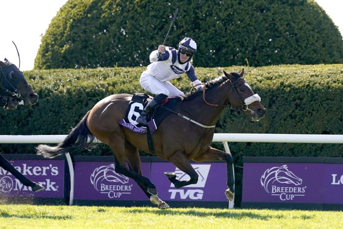 Tom Eaves (6) celebrates atop Glass Slippers after winning the Breeder's Cup Turf Sprint horse race at Keeneland Race Course, in Lexington, Ky., Saturday, Nov. 7,2020. (AP Photo/Michael Conroy)
