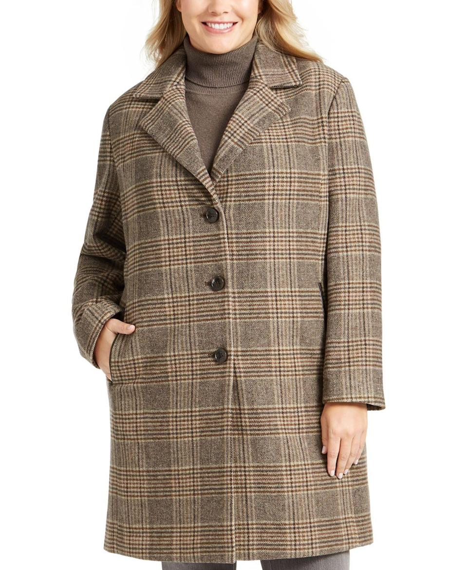 """<p><strong>DKNY</strong></p><p>macys.com</p><p><strong>$161.49</strong></p><p><a href=""""https://go.redirectingat.com?id=74968X1596630&url=https%3A%2F%2Fwww.macys.com%2Fshop%2Fproduct%2Fdkny-plus-size-plaid-faux-leather-trim-walker-coat-created-for-macys%3FID%3D9399918&sref=https%3A%2F%2Fwww.oprahmag.com%2Fstyle%2Fg33266496%2Fplus-size-coats%2F"""" rel=""""nofollow noopener"""" target=""""_blank"""" data-ylk=""""slk:SHOP NOW"""" class=""""link rapid-noclick-resp"""">SHOP NOW</a></p><p>If you want a coat that could be mistaken for something you'd find in your grandmother's retro-chic closet yet also feels modern, this car coat featuring menswear-inspired plaid is a great option. </p>"""