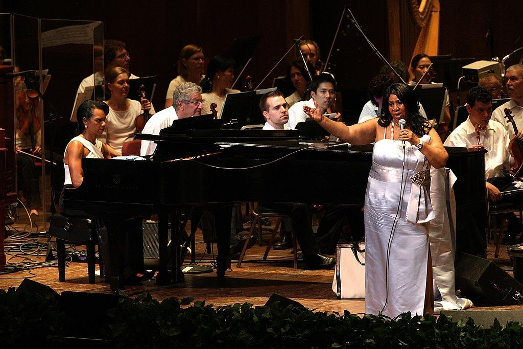 "Aretha Franklin teamed up with former U.S. Secretary of State, and accomplished pianist, Condoleezza Rice to perform with the Philadelphia Orchestra at a gala benefit Tuesday night. ""You didn't think she could play it, right?"" the Queen of Soul teased the audience when Rice launched into a rendition of ""I Say a Little Prayer."" Bill McCay/<a href=""http://www.wireimage.com"" target=""new"">WireImage.com</a> - July 27, 2010"