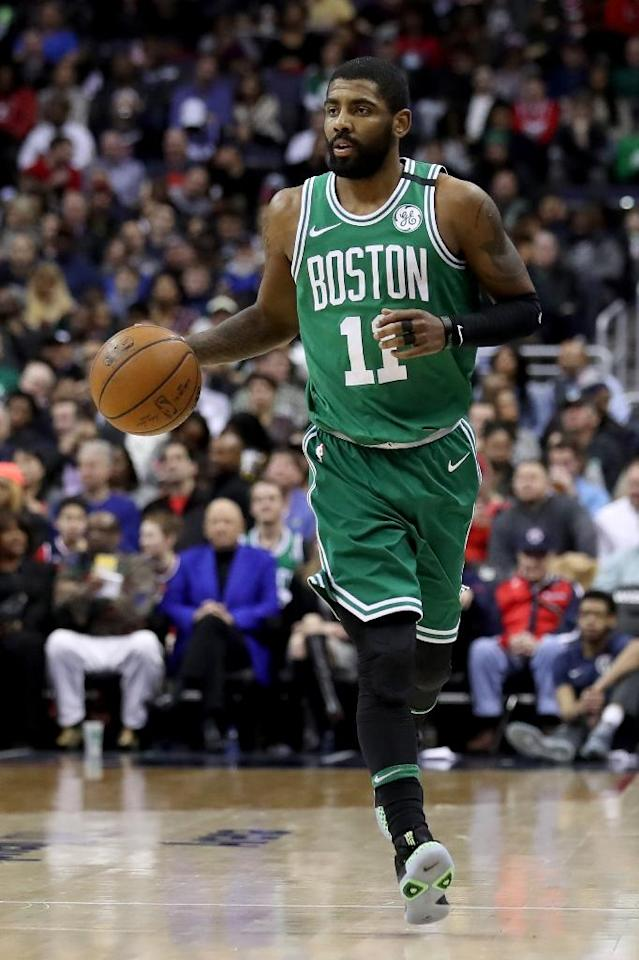 Kyrie Irving of the Boston Celtics dribbles the ball during their game against the Washington Wizards, at Capital One Arena in Washington, DC, on February 8, 2018 (AFP Photo/Rob Carr)