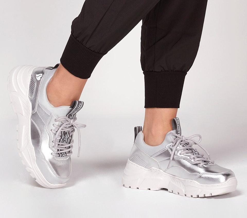"""<h3><a href=""""https://www.skechers.com/en-us/style/74247/b-rad-the-biz/SIL"""" rel=""""nofollow noopener"""" target=""""_blank"""" data-ylk=""""slk:Skechers B-Rad The Biz Sneakers"""" class=""""link rapid-noclick-resp"""">Skechers B-Rad The Biz Sneakers</a></h3><br>""""I have an old pair of Skechers that can get me through any airport dash and then later jogging on the beach."""" <em>– Rebecca, travels 6-7 times per year</em>""""<br><br><strong>Skechers</strong> B-Rad - The Biz, $, available at <a href=""""https://www.skechers.com/en-us/style/74247/b-rad-the-biz/SIL"""" rel=""""nofollow noopener"""" target=""""_blank"""" data-ylk=""""slk:Skechers"""" class=""""link rapid-noclick-resp"""">Skechers</a>"""