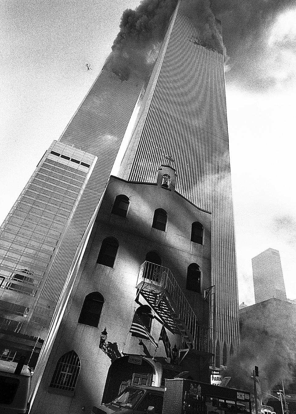 In this Sept. 11, 2001, photo provided by the Greek Orthodox Archdiocese of America, smoke billows from the World Trade Center towers as St. Nicholas Greek Orthodox Church sits below them in New York's financial district. St. Nicholas was the only house of worship destroyed in the Sept. 11, 2001 attacks. (Greek Orthodox Archdiocese of America via AP)