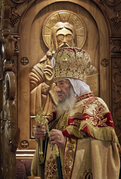 FILE - In this Thursday, Jan. 6, 2011 file photo, Coptic Pope Shenouda III leads Christmas Eve Mass at the Coptic cathedral in Cairo, Egypt. Egypt's state news agency says Pope Shenouda III, head of Coptic Christian church, has died.(AP Photo/Ben Curtis, File)