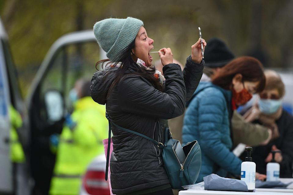 People take part in coronavirus surge testing on Clapham Common, south London, on Wednesday  (Photo: Kirsty O'Connor - PA Images via PA Images via Getty Images)