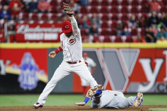 Cincinnati Reds second baseman Scooter Gennett (3) completes a double play by forcing out Los Angeles Dodgers' Max Muncy, right, in the seventh inning of a baseball game, Monday, Sept. 10, 2018, in Cincinnati. (AP Photo/John Minchillo)