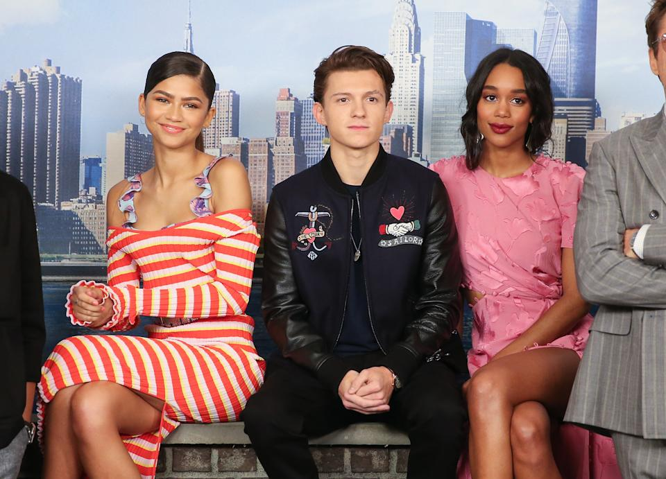 """NEW YORK, NY - JUNE 25:  (L-R) Zendaya, Tom Holland and Laura Harrier attend the """"Spider-Man: Homecoming"""" Photo Call at the Whitby Hotel on June 25, 2017 in New York City.  (Photo by Rob Kim/Getty Images)"""