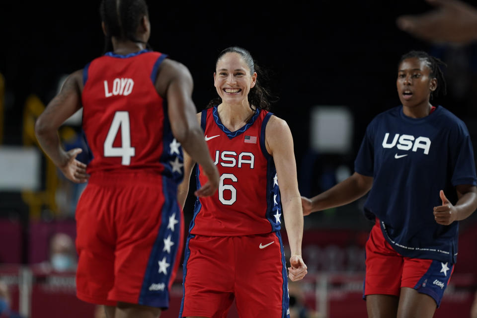 United States' Sue Bird (6), center, celebrates score by teammate Jewell Loyd (4) during women's basketball preliminary round game at the 2020 Summer Olympics, Tuesday, July 27, 2021, in Saitama, Japan. (AP Photo/Eric Gay)