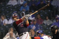 Washington Nationals' Ryan Zimmerman watches his RBI single off Chicago Cubs starting pitcher Zach Davies during the fifth inning of a baseball game Tuesday, May 18, 2021, in Chicago. (AP Photo/Charles Rex Arbogast)