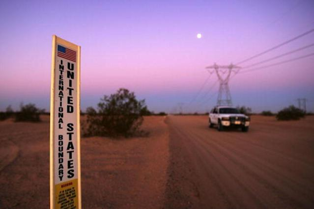 WINTERHAVEN, CA - OCTOBER 08: An unmarked US Customs and Border Protection (CBP) border patrol vehicle drives along US-Mexico border where no fence divides the US (R) from Mexico (L) before dawn near the Imperial Dunes October 8, 2006 west of Winterhaven, California. US Fish and Wildlife Service wardens and environmentalists warn that a proposed plan by US lawmakers to construct 700 miles of double fencing along the 2,000-mile US-Mexico border, in an attempt to wall-out illegal immigrants, would also harm rare wildlife. Wildlife experts say cactus-pollinating insects would fly around fence lights, birds that migrate by starlight in the desert wilderness would be confused; and large mammals such as jaguars, Mexican wolves, Sonoran pronghorn antelope, and desert bighorn sheep would be blocked from migrating across the international border, from California to Texas. (Photo by David McNew/Getty Images)