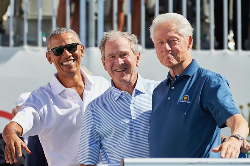 JERSEY CITY, NJ - SEPTEMBER 28: Presidents Obama, G.W. Bush, and Bill Clinton smile and wave while on the first tee during the first round of the Presidents Cup at Liberty National Golf Club on September 28, 2017 in Jersey City, New Jersey. (Photo by Shelley Lipton/Icon Sportswire via Getty Images)