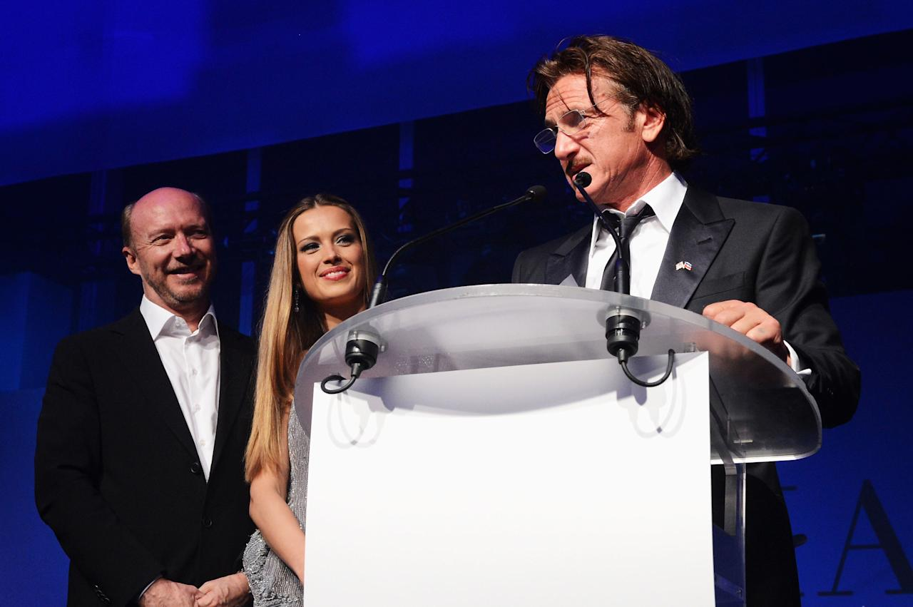 CANNES, FRANCE - MAY 18:  (L-R) Director Paul Haggis, model Petra Nemcova and actor Sean Penn attend the Haiti Carnival in Cannes Benefitting J/P HRO, Artists for Peace and Justice & Happy Hearts Fund Presented By Armani during the 65th Annual Cannes Film Festival on May 18, 2012 in Cannes, France.  (Photo by Michael Buckner/Getty Images)