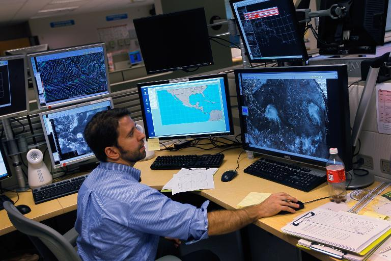 A hurricane forcaster studies computer models as he tracks Hurricane Irene at the National Hurricane Center on August 22, 2011 in Miami, Florida