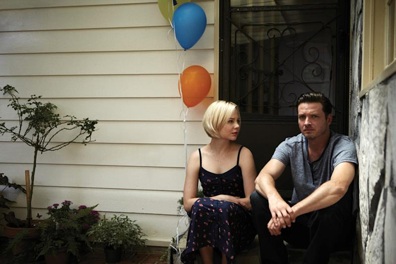 """This publicity image released by the Sundance Channel shows Adelaide Clemens, left, and Aden Young in a scene from the drama series """"Rectify."""" The six-hour miniseries, whose first two hours air on Sundance Channel on Monday at 9 p.m., tells a unique story about a man who was caged for two decades for the rape and murder of his teenage girlfriend. Then, when his conviction is vacated thanks to new DNA evidence, he is restored to an outside world that proves just as harrowing. (AP Photo/Sundance Channel)"""
