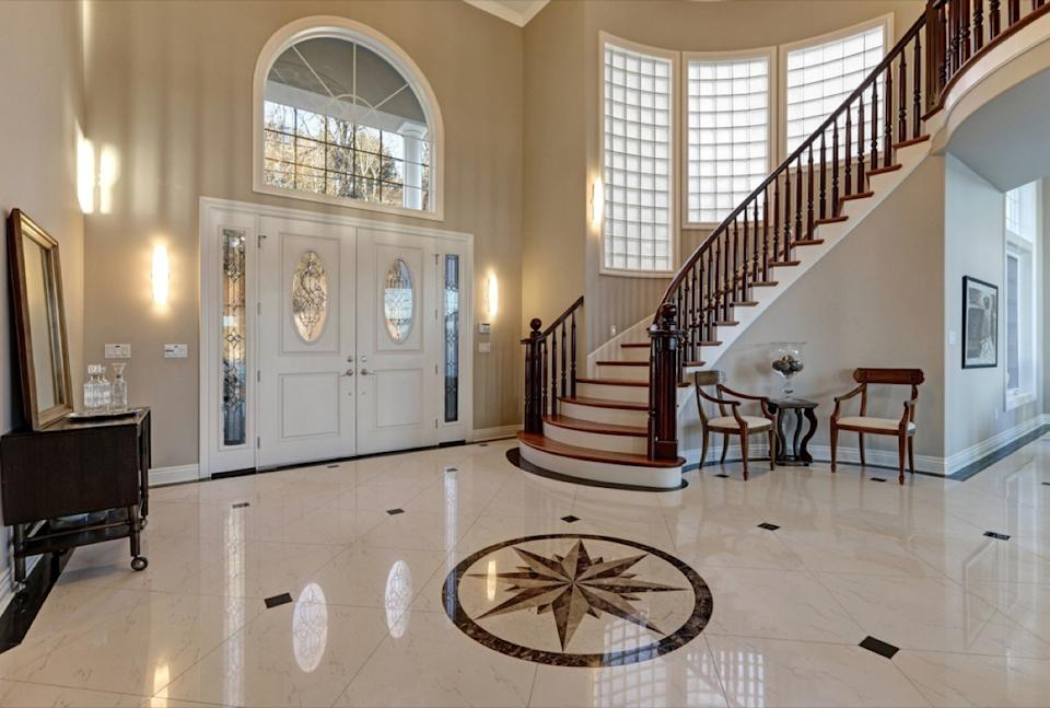 marble double height foyer with nautical design in center