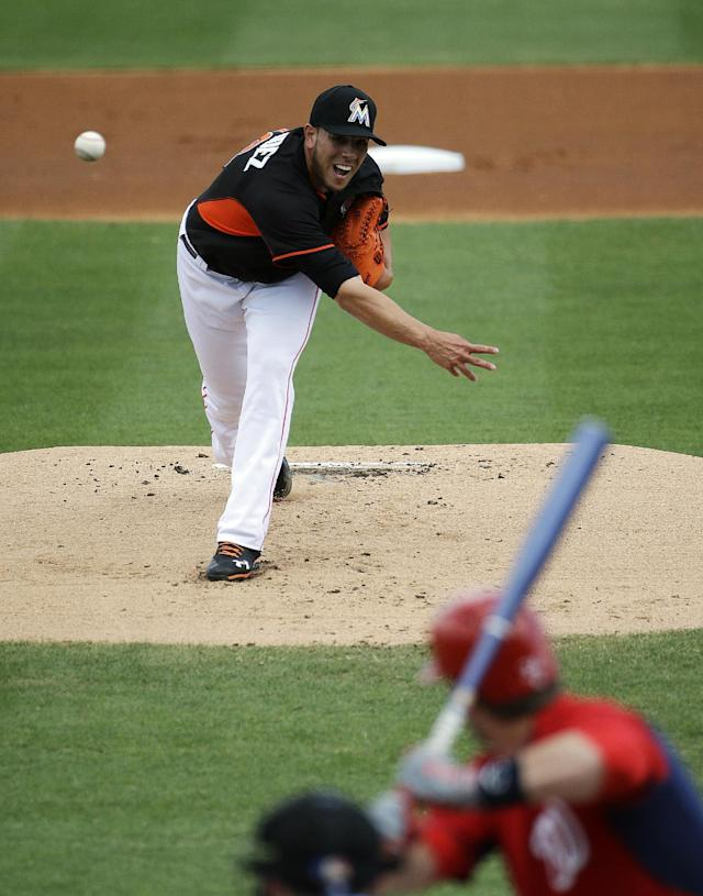 Miami Marlins starting pitcher Jose Fernandez, top, throws to Washington Nationals' Bryce Harper in the first inning of an exhibition spring training baseball game, Saturday, March 15, 2014, in Jupiter, Fla. (AP Photo/David Goldman)
