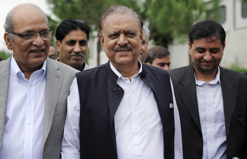 Mamnoon Hussain, center, a candidate from ruling party Pakistan Muslim League-N arrives with his party leaders to submit his nomination papers for the upcoming presidential election in Islamabad, Pakistan, Wednesday, July 24, 2013. Pakistani political parties have nominated their candidates for the upcoming presidential elections with the ruling party's candidate seen as the front-runner. (AP Photo/Anjum Naveed)