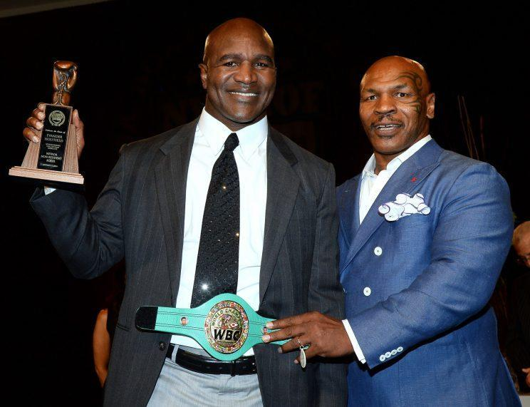 Arch rival Mike Tyson (R) presented Holyfield for induction into the Nevada Boxing Hall of Fame in 2014. (Getty Images)