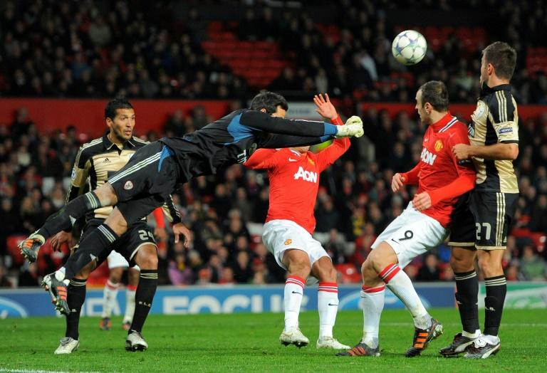 Benfica's players fight for the ball with Manchester United's footballers during an UEFA Champions League match at Old Trafford in Manchester, in 2011