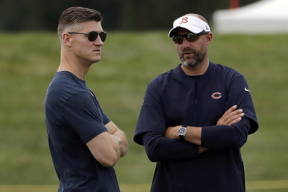 Chicago Bears head coach Matt Nagy, right, talks with general manager Ryan Pace during NFL football training camp in Bourbonnais, Ill. The Bears and every other team around the NFL are staring at a season like no other because of the COVID-19 pandemic. Veterans started reporting to camps this week. But instead of jumping right into the grind, they're taking a slower approach  (AP Photo/Nam Y. Huh, File)