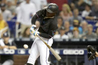 Miami Marlins' Jazz Chisholm hits a single during the first inning of the team's baseball game against the New York Yankees, Friday, July 30, 2021, in Miami. (AP Photo/Lynne Sladky)