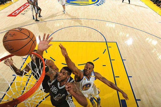 Spurs forward LaMarcus Aldridge finished with 26 points and 14 rebounds against the Warriors. (Getty Images)