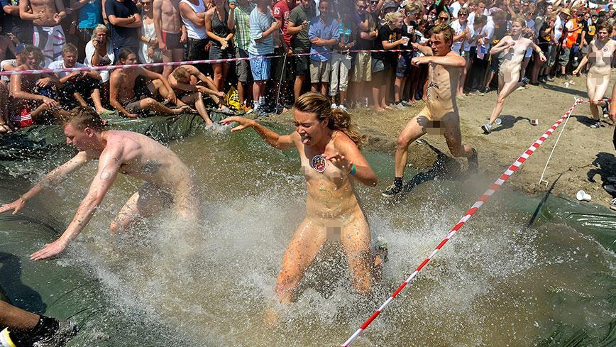 Wearing nothing but shoes, the buff athletes took on an obstacle course while crowds watched on.