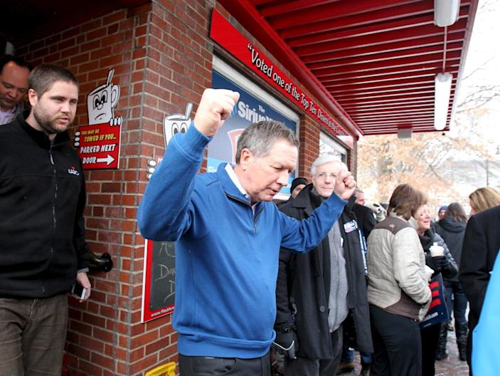 <p>Republican presidential candidate Ohio Gov. John Kasich pumps his fists as he leaves the Red Arrow Diner during a campaign stop in Manchester, N.H., on Feb. 9, 2016. <i>(Photo: Mary Schwalm/Reuters)</i></p>