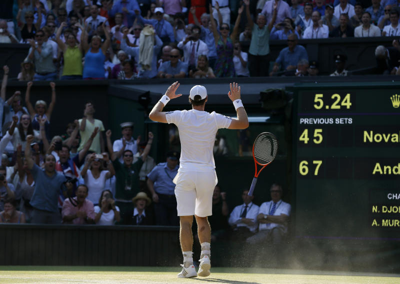 Andy Murray of Britain reacts after defeating Novak Djokovic of Serbia during the Men's singles final match at the All England Lawn Tennis Championships in Wimbledon, London, Sunday, July 7, 2013. (AP Photo/Kirsty Wigglesworth)