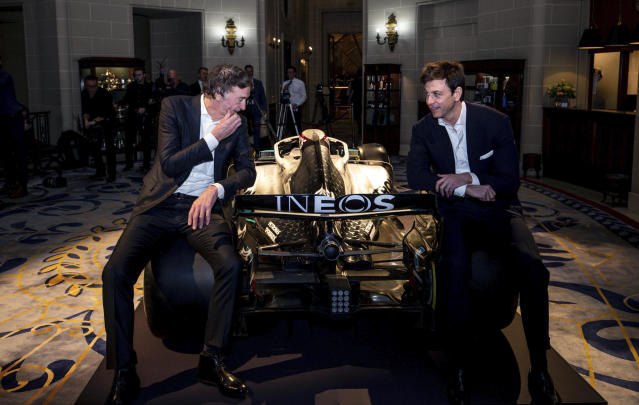 Toto Wolff, Team Principal & CEO of The Mercedes AMG-PETRONAS F1 Team, right, and INEOS Founder and Chairman Jim Ratcliffe pose for a photo with a Mercedes F1 car and its 2020 livery during a media briefing in London, Monday, Feb. 10, 2020. The Mercedes Formula One team is still waiting to secure a long-term commitment from world champion Lewis Hamilton. Wolff says he hasn't spoken to Hamilton since the Christmas party after agreeing to leave each other in peace in the offseason. Mercedes has longer certainty from its new sponsor INEOS, the chemicals giant owned by Jim Ratcliffe. (Steven Paston/PA via AP)