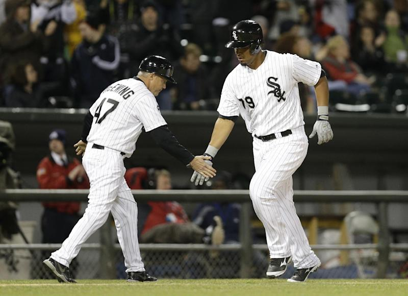 Chicago White Sox's Jose Abreu, right, celebrates with third base coach Joe McEwing after hitting a solo home run during the fifth inning of a baseball game against the Cleveland Indians in Chicago, Thursday, April 10, 2014. (AP Photo/Nam Y. Huh)