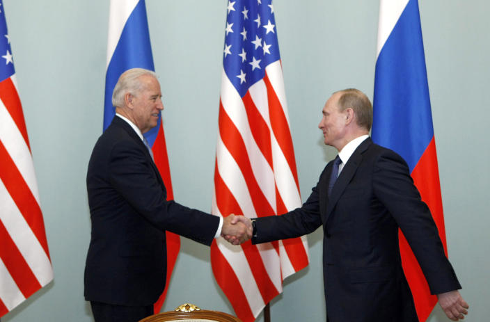 FILE - In this March 10, 2011 file photo, then U.S. Vice President Joe Biden, left, shakes hands with Russian Prime Minister Vladimir Putin in Moscow. (AP Photo/Alexander Zemlianichenko)