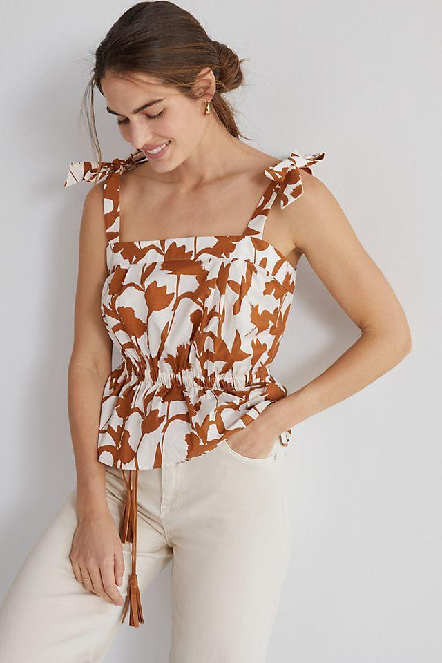 """<br><br><strong>Corey Lynn Calter</strong> Floral Peplum Tank, $, available at <a href=""""https://go.skimresources.com/?id=30283X879131&url=https%3A%2F%2Fwww.anthropologie.com%2Fshop%2Fcorey-lynn-calter-floral-peplum-tank"""" rel=""""nofollow noopener"""" target=""""_blank"""" data-ylk=""""slk:Anthropologie"""" class=""""link rapid-noclick-resp"""">Anthropologie</a>"""