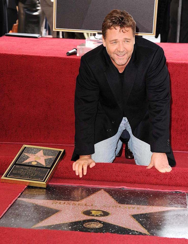 """Russell Crowe made it a family affair as he received his star on the Hollywood Walk of Fame Monday. The """"Robin Hood"""" actor was joined by his wife and two kids, as well as Jay Leno and director Ron Howard. Steve Granitz/<a href=""""http://www.wireimage.com"""" target=""""new"""">WireImage.com</a> - April 12, 2010"""