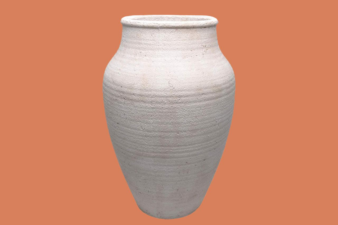 "<p>This cement vase will be your new go-to thanks to its versatility and subtle texture. At 26 inches in height it will definitely make an impact&mdash;and take up any empty space you want to fill&mdash;without breaking the bank.</p><p><em><strong>Shop Now: </strong>Moe's Home Collection ""Voz Vase,"" $147.43, </em><em><a href=""https://www.amazon.com/Moes-Home-Collection-Vase-White/dp/B07PVJJ2N6/ref=as_li_ss_tl?ie=UTF8&amp;linkCode=ll1&amp;tag=mslhomevintagejarvaseshbakeroct19-20&amp;linkId=bca3251c216f2bc4e6fd9273ea2d1784&amp;language=en_US"">amazon.com</a>.</em></p>"