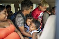 A group of migrants at the shelter in Matamoros board a van to go get tested for Covid-19
