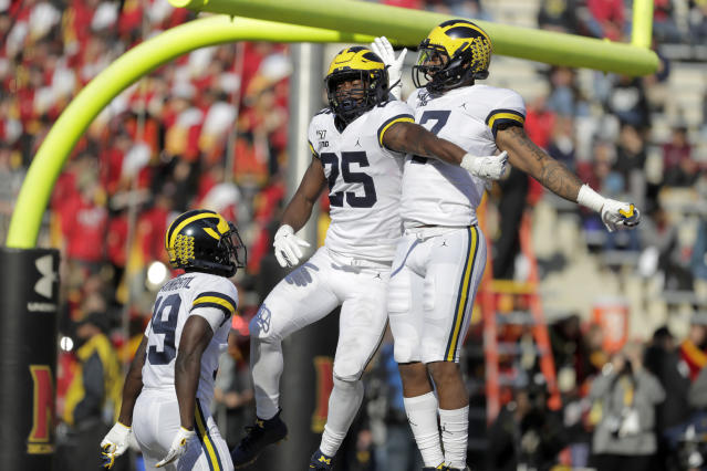 Michigan running back Hassan Haskins (25) celebrates his touchdown run against Maryland with wide receivers Tarik Black (7) and Mike Sainristil (19) during the second half of an NCAA college football game, Saturday, Nov. 2, 2019, in College Park, Md. Michigan won 38-7. (AP Photo/Julio Cortez)