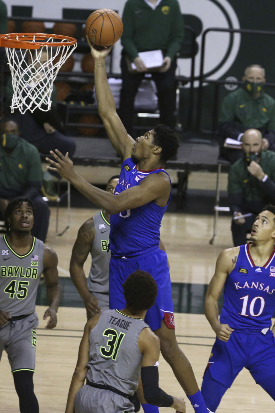 Kansas forward David McCormack (33) scores past Baylor guard Davion Mitchell (45) in the first half of an NCAA college basketball game, Monday, Jan. 18, 2021, in Waco, Texas. (AP Photo/Jerry Larson)