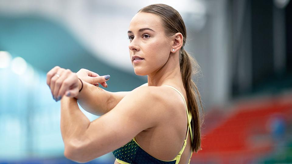Pictured here, Australian swimmer Brianna Throssell stretches before a race.